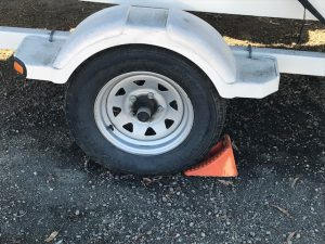 Blocking the trailer wheel is how to winterize a boat.